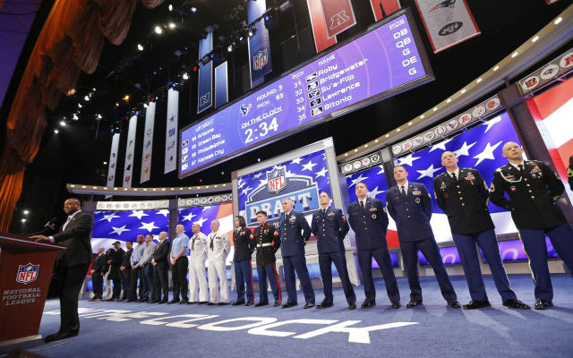Members of the United States military line the stage as the Chicago Bears' third-round pick, Will Sutton of Arizona State, is announced during the 2014 NFL Draft, Friday, May 9, 2014, in New York. (AP Photo/Jason DeCrow)