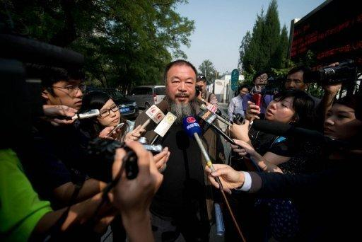 Ai Weiwei denies allegations of tax evasion by the company he founded