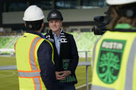Q2 Holdings Inc. CEO Matt Flake, center, talks with the media following a ribbon cutting where the Austin FC's new stadium was named Q2 Stadium, Monday, Jan. 25, 2021, in Austin, Texas. (AP Photo/Eric Gay)