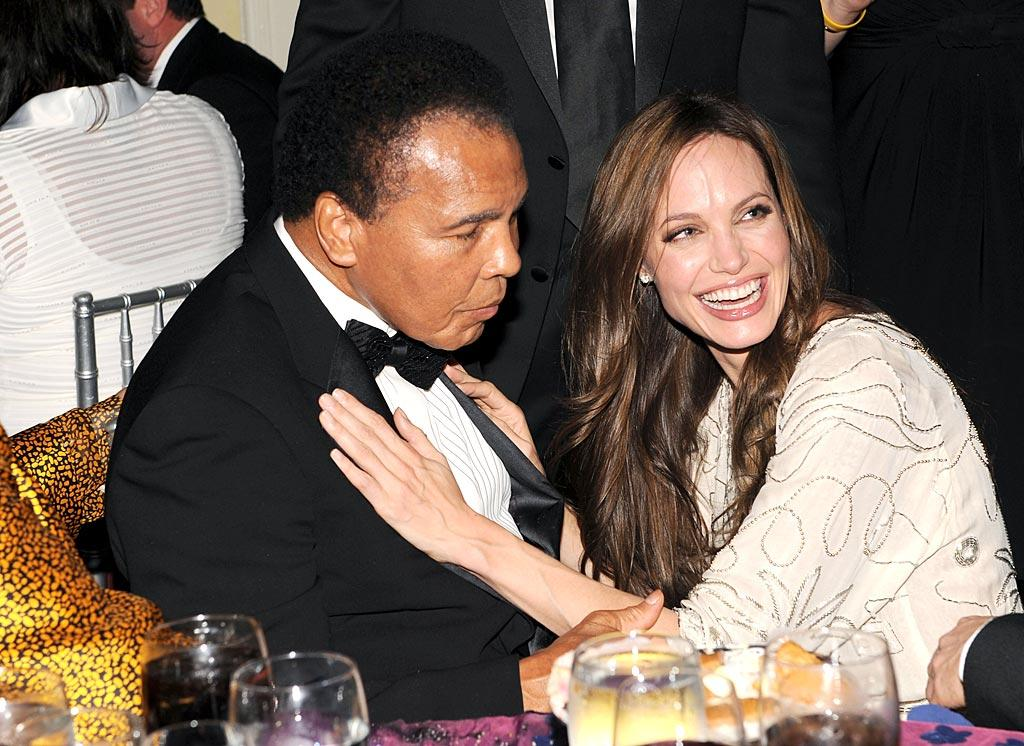 "Angie got up close and personal with boxing legend Muhammad Ali. Kevin Mazur/<a href=""http://www.wireimage.com"" target=""new"">WireImage.com</a> - December 10, 2009"