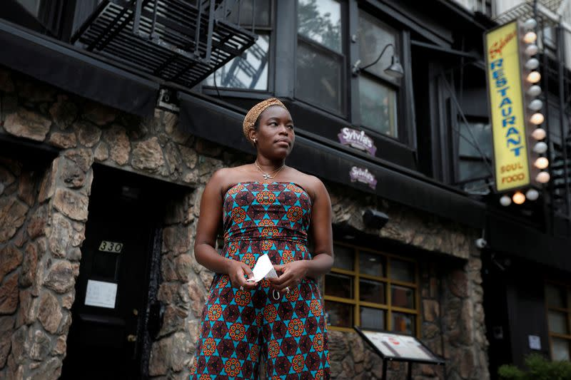 Tren'ness Woods-Black, granddaughter of the late Sylvia Woods, poses outside Sylvia's Restaurant in Harlem in New York