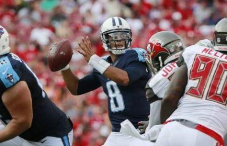 Sep 13, 2015; Tampa, FL, USA; Tennessee Titans quarterback Marcus Mariota (8) throws the ball against the Tampa Bay Buccaneers during the second half at Raymond James Stadium. Mandatory Credit: Kim Klement-USA TODAY Sports