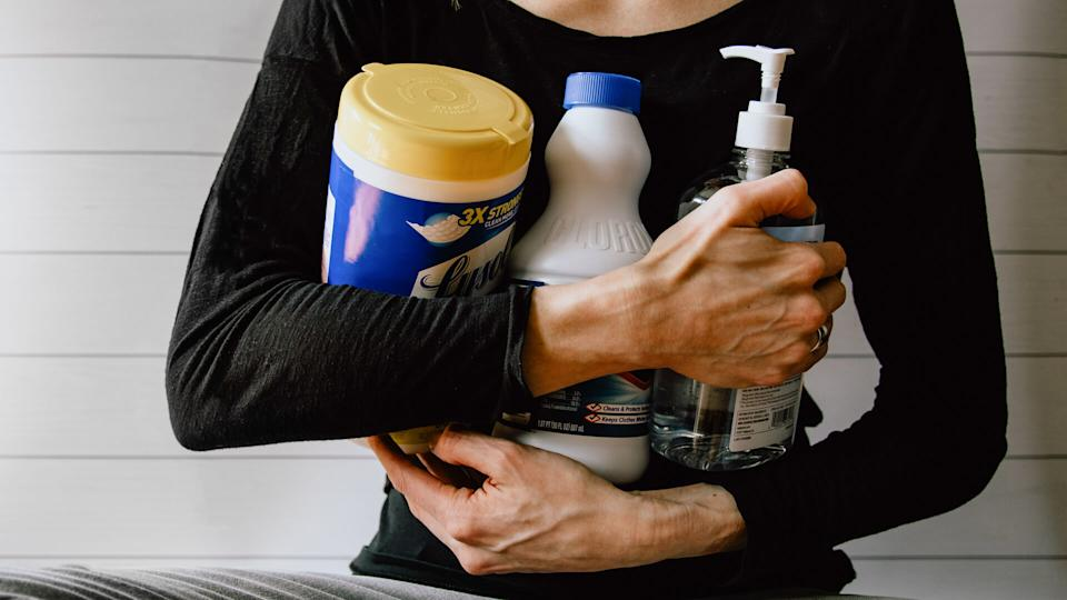woman with disinfecting supplies