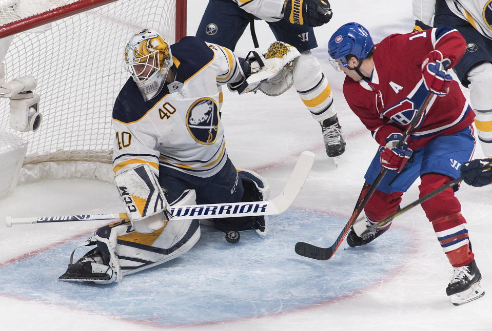 Montreal Canadiens' Brendan Gallagher (11) moves in on Buffalo Sabres goaltender Carter Hutton during first period NHL hockey action in Montreal, Saturday, March 23, 2019. (Graham Hughes/The Canadian Press via AP)