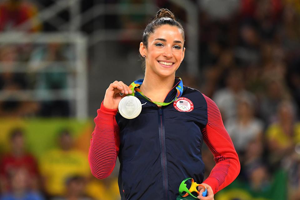 Aly Raisman poses with one of her silver medals at the 2016 Rio Olympics. She finished second in the all-around and floor competitions.