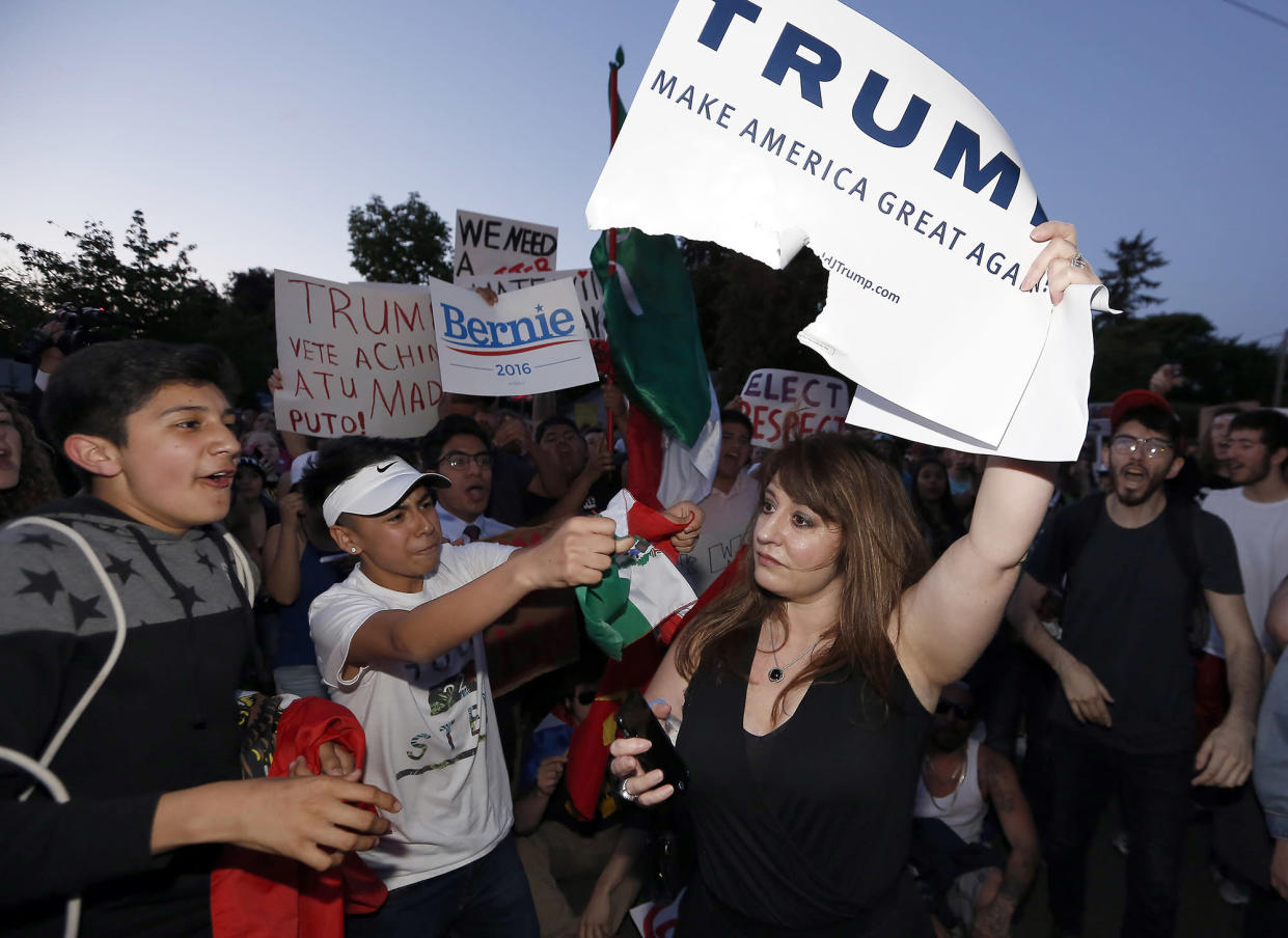 Passionate opposition: Donald Trump supporter is yelled at by protestors following a rally in Eugene, Ore., on May 6, 2016. (Photo: Ryan Kang/AP)