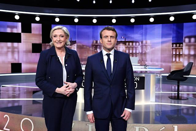 <p>French presidential election candidate for the far-right Front National party, Marine Le Pen, left, and French presidential election candidate for the En Marche ! movement, Emmanuel Macron, pose prior to the start of a live broadcast face-to-face televised debate in La Plaine-Saint-Denis, north of Paris, France, Wednesday, May 3, 2017 as part of the second round election campaign. Pro-European progressive Emmanuel Macron and far-right Marine Le Pen are facing off in their only direct debate before Sunday's presidential runoff election. (Eric Feferberg/Pool Photo via AP) </p>