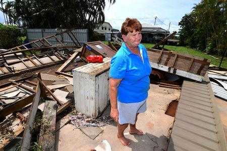Local resident Helen Muller stands in a part of her home that was damaged by Cyclone Debbie in the town of Proserpine, located south of the northern Queensland town of Townsville in Australia. AAP/Dan Peled/via REUTERS