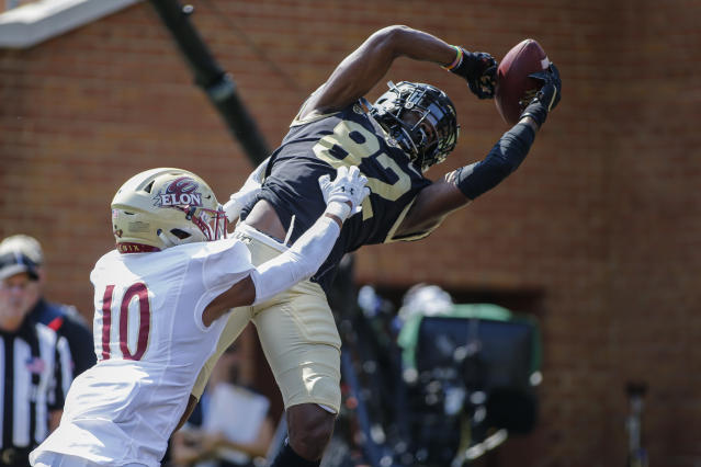Elon defensive back Tre'Von Jones (10) pushes Wake Forest wide receiver Jaquarii Roberson out of bounds for an incomplete pass in the first half of an NCAA college football game in Winston-Salem, N.C., Saturday, Sept. 21, 2019. (AP Photo/Nell Redmond)