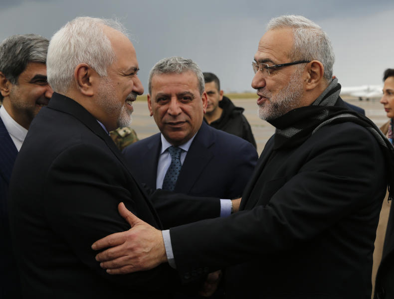 Iran's Foreign Minister Mohammad Javad Zarif left is greeted by Lebanese Minister of State Parliamentary Affairs and a member of Hezbollah politicians block Mahmoud Qmati right on his arrival at Rafik Hariri Airport in Beirut Lebanon Sunday F