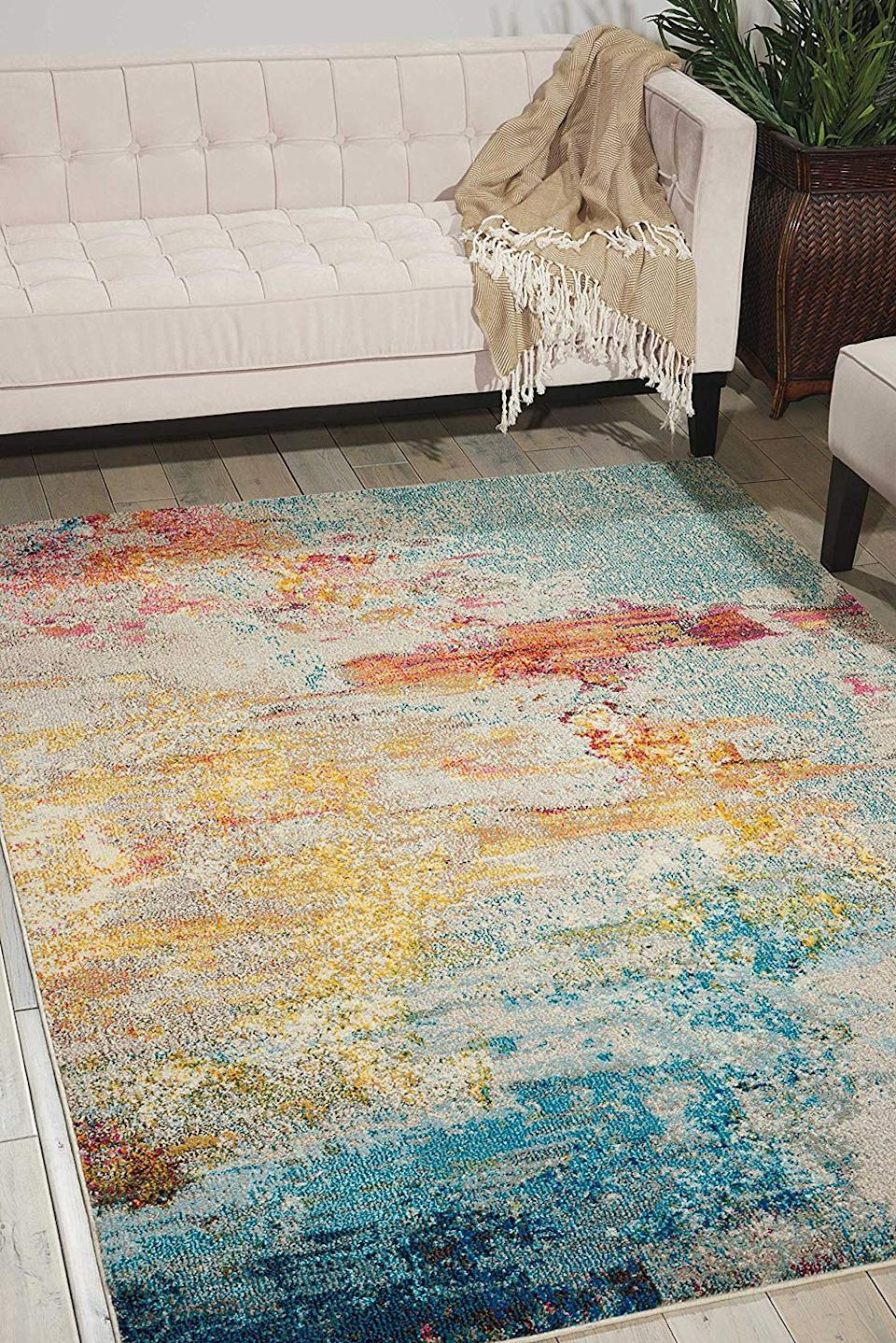 """<a href=""""https://www.amazon.com/dp/B01K6MHLQC?slotNum=1"""" rel=""""nofollow noopener"""" target=""""_blank"""" data-ylk=""""slk:Nourison Celestial Modern Abstract Rug"""" class=""""link rapid-noclick-resp""""><h3>Nourison Celestial Modern Abstract Rug<br></h3></a><br>We love a good shag rug as much as the next gal, but for a decor choice that'll set your aesthetic apart from all your friends, consider this celestial area rug inspired by the coral reef.<br><br><strong>Nourison</strong> Modern Abstract Area Rug, $, available at <a href=""""https://www.amazon.com/Nourison-Celestial-Modern-Abstract-Multicolor/dp/B01K6MHLQC/"""" rel=""""nofollow noopener"""" target=""""_blank"""" data-ylk=""""slk:Amazon"""" class=""""link rapid-noclick-resp"""">Amazon</a>"""