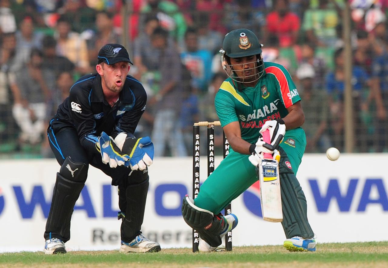 Bangladesh batsman Shamsur Rahman (R) plays a shot as New Zealand wicketkeeper Luke Ronchi looks on during the third One-Day International (ODI) cricket match between Bangladesh and New Zealand at Khan Jahan Ali Stadium in Fatullah, on the outskirts of Dhaka on November 3, 2013.  AFP PHOTO/ Munir uz ZAMAN        (Photo credit should read MUNIR UZ ZAMAN/AFP/Getty Images)