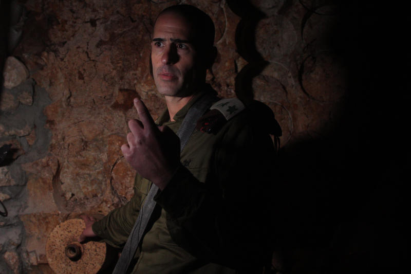 Col. Roy Levy, the commander of Israel's Northern Border Brigade, speaks inside a tunnel that the army says crosses from Lebanon to Israel, Northern Israel, Thursday, Dec. 5, 2019. A year after uncovering a network of cross-border Hezbollah tunnels, the Israeli military says the Lebanese militant group has beefed up its presence along the volatile frontier. (AP Photo/Patty Nieberg)