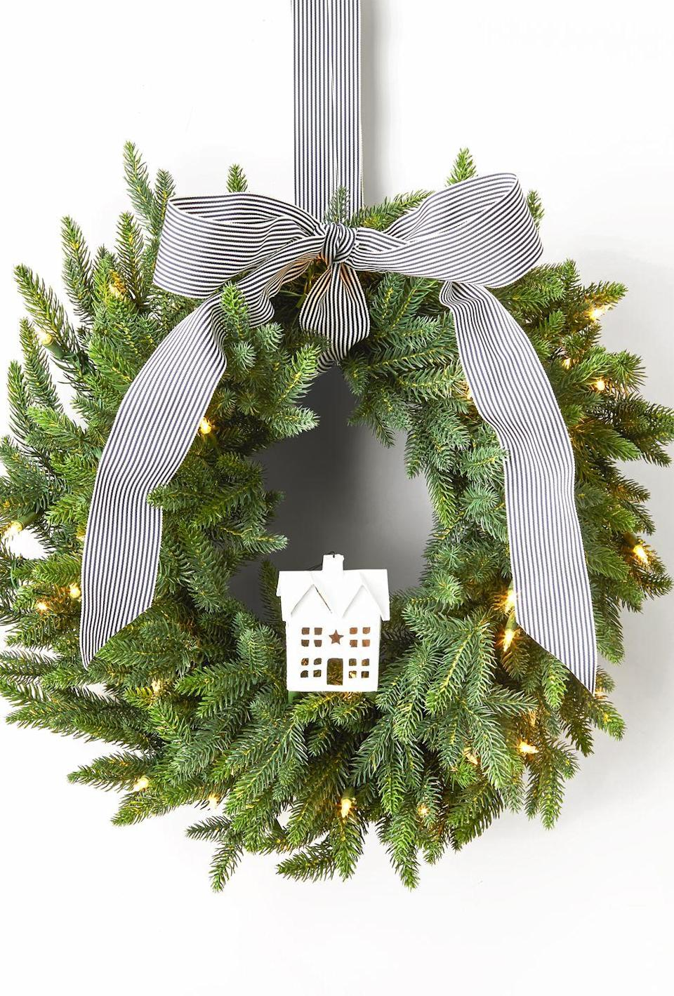 "<p>If the Christmas village on your mantle is too crowded, take one of the ceramic houses and add it to the center of a wreath, hinting at what visitors can expect inside.</p><p><a class=""link rapid-noclick-resp"" href=""https://www.amazon.com/Mark-Feldstein-Porcelain-Tabletop-Christmas/dp/B07HM6QT14/?tag=syn-yahoo-20&ascsubtag=%5Bartid%7C10055.g.2361%5Bsrc%7Cyahoo-us"" rel=""nofollow noopener"" target=""_blank"" data-ylk=""slk:SHOP CERAMIC HOUSES"">SHOP CERAMIC HOUSES</a></p>"
