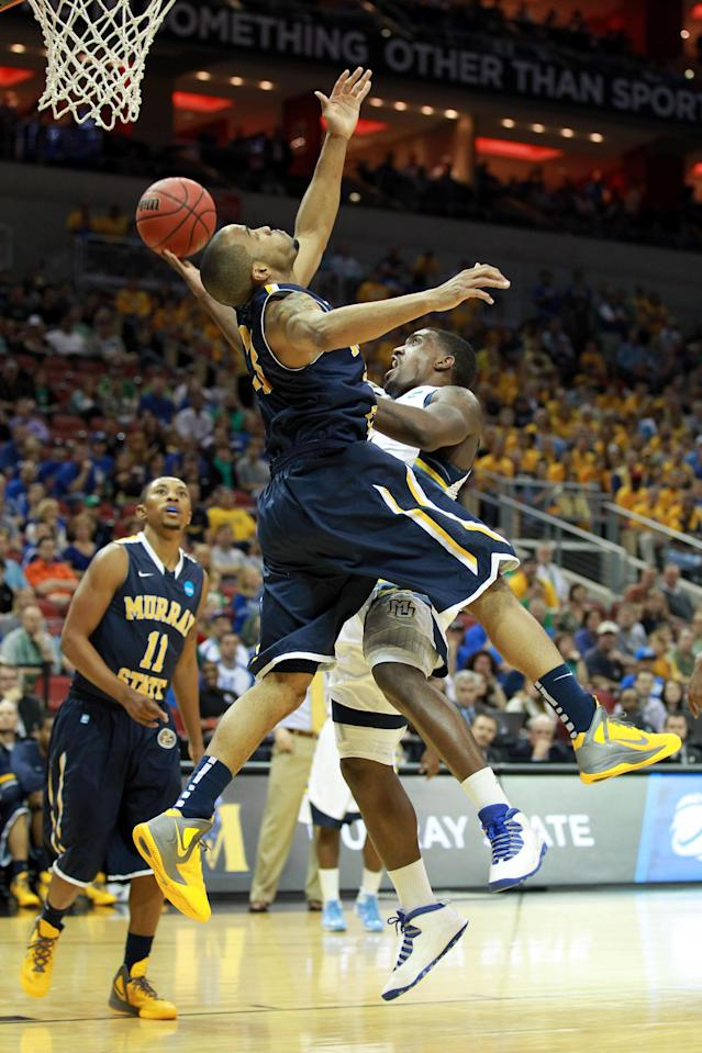 LOUISVILLE, KY - MARCH 17: Darius Johnson-Odom #1 of the Marquette Golden Eagles goes up for a shot against Jewuan Long #33 of the Murray State Racers in the first half during the third round of the 2012 NCAA Men's Basketball Tournament at KFC YUM! Center on March 15, 2012 in Louisville, Kentucky. (Photo by Andy Lyons/Getty Images)