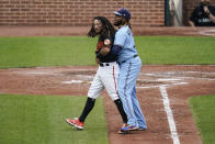 Baltimore Orioles' Freddy Galvis, left, is restrained by Toronto Blue Jays first base Vladimir Guerrero Jr. during a benches-clearing argument in the fourth inning of a baseball game, Saturday, June 19, 2021, in Baltimore. The incident happened as a result of Blue Jays' starting pitcher Alek Manoah hitting Orioles' Maikel Franco with a pitch after Manoah gave up back-to-back home runs to Ryan Mountcastle and DJ Stewart. (AP Photo/Julio Cortez)