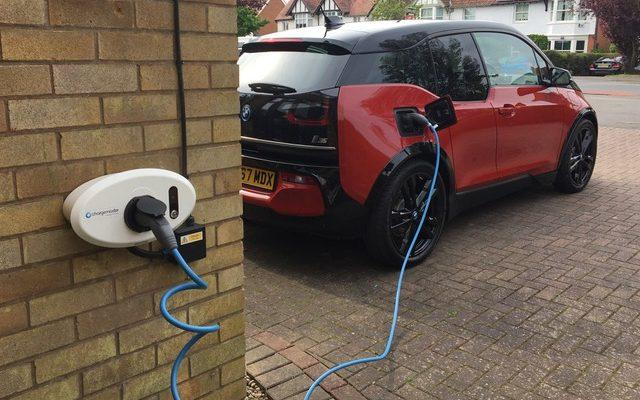 BMW i3 being charge on driveway