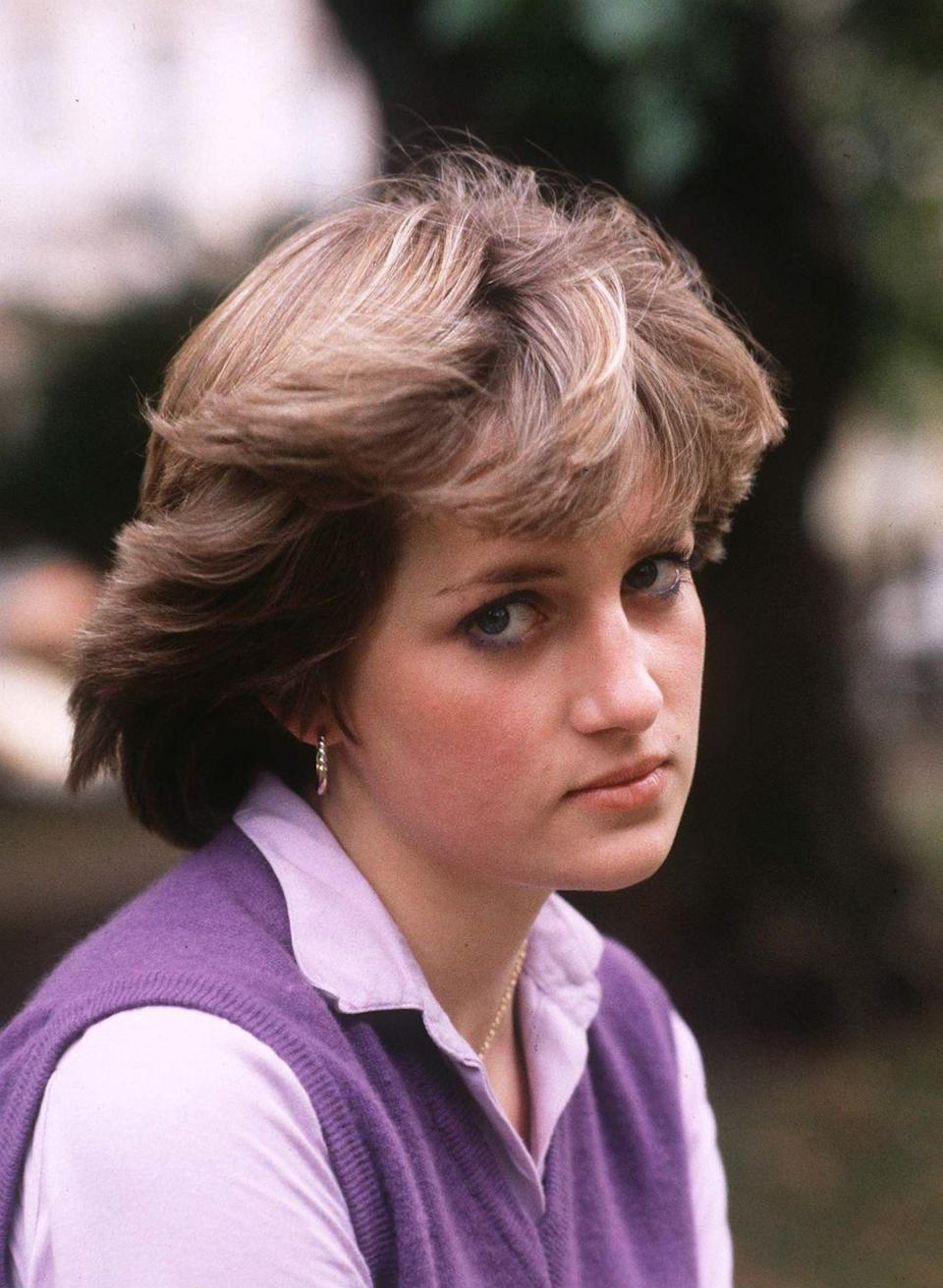 """<p>Diana looks pensive in this portrait of her at age 19, when she was still a teacher <a href=""""https://www.youngenglandkindergarten.co.uk/Young-England-in-the-news/"""" rel=""""nofollow noopener"""" target=""""_blank"""" data-ylk=""""slk:The Young England Kindergarten Nursery School"""" class=""""link rapid-noclick-resp"""">The Young England Kindergarten Nursery School </a>in Pimlico, London.</p>"""