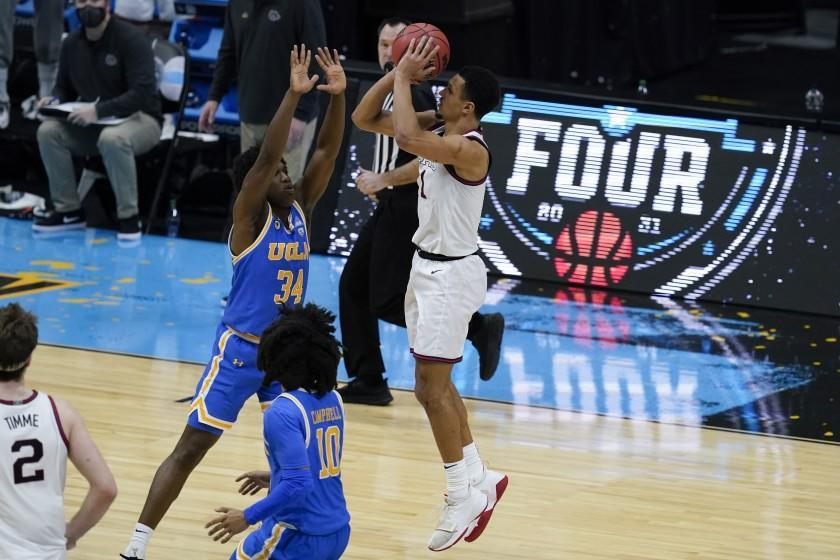 Gonzaga guard Jalen Suggs (1) shoots over UCLA guard David Singleton (34) to win the game during overtime.