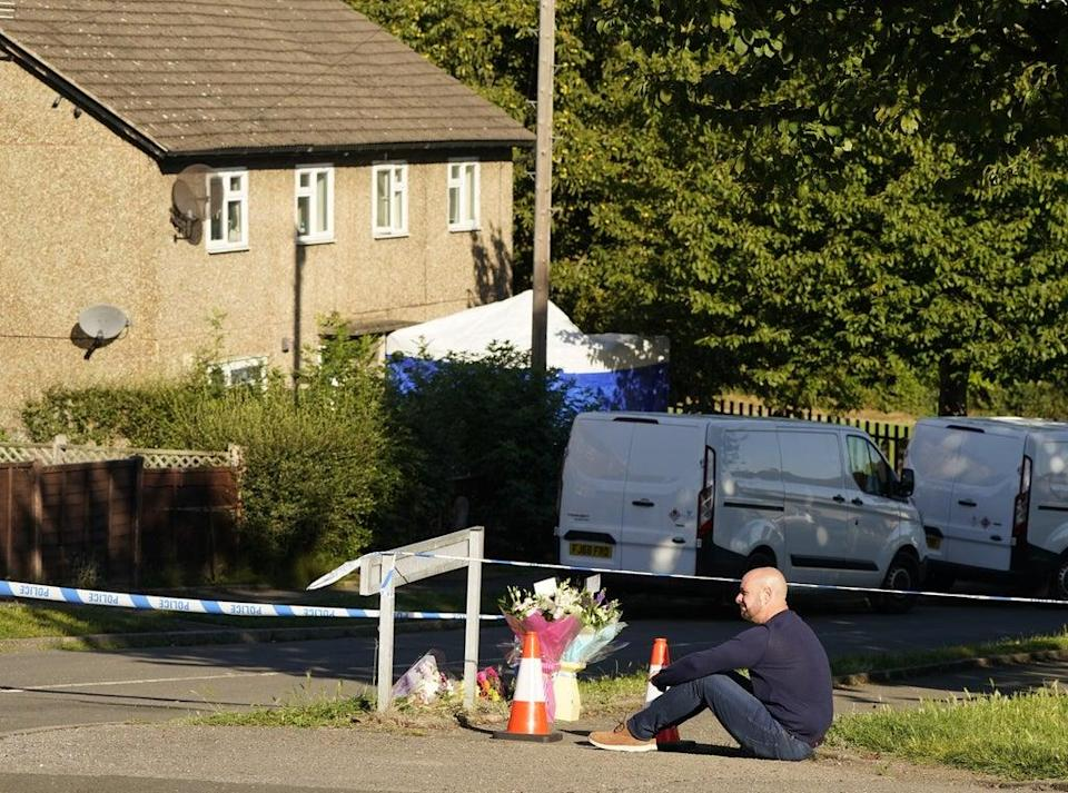 The father to some of the victims leaves flowers at the scene in Chandos Crescent, Killamarsh (Danny Lawson/PA) (PA Wire)