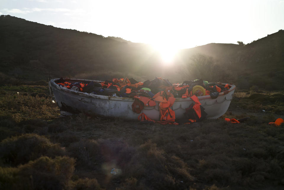 <p>A wooden boat full of life jackets used by refugees and migrants to cross the Aegean sea from the Turkish coast remains on the shore of the Greek island of Lesbos, Nov. 23 , 2015. (Photo: Muhammed Muheisen/AP) </p>