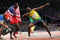 Bronze medalist Justin Gatlin of the United States and gold medalist Usain Bolt of Jamaica celebrate after competing in the Men?s 100m Final on Day 9 of the London 2012 Olympic Games at the Olympic Stadium on August 5, 2012 in London, England. (Photo by Michael Steele/Getty Images)