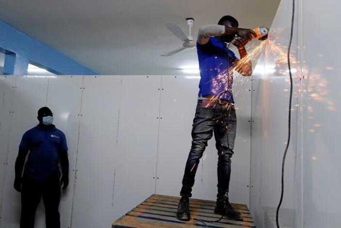 FILE PHOTO: Workers prepare new cold rooms to store the country's stock of vaccines, including those for COVID-19, at the Fann Hospital in Dakar