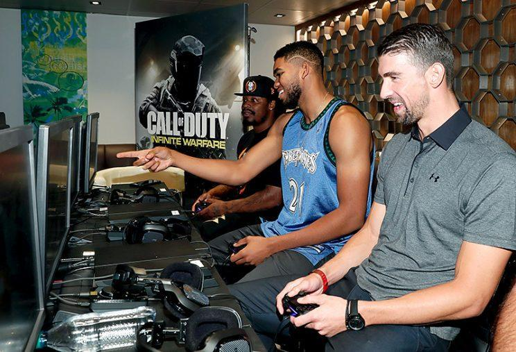 Phelps played alongside retired (for now?) NFL player Marshawn Lynch (far left) and NBA player Karl-Anthony Towns. (Photo: Rich Polk/Getty Images for Activision)