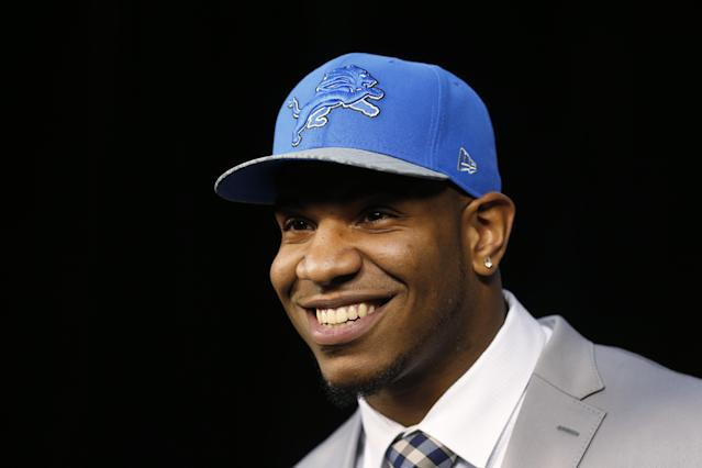 Detroit Lions NFL football first-round draft choice, 10th overall, North Carolina tight end Eric Ebron smiles during a news conference in Allen Park, Mich., Friday, May 9, 2014. (AP Photo/Paul Sancya)