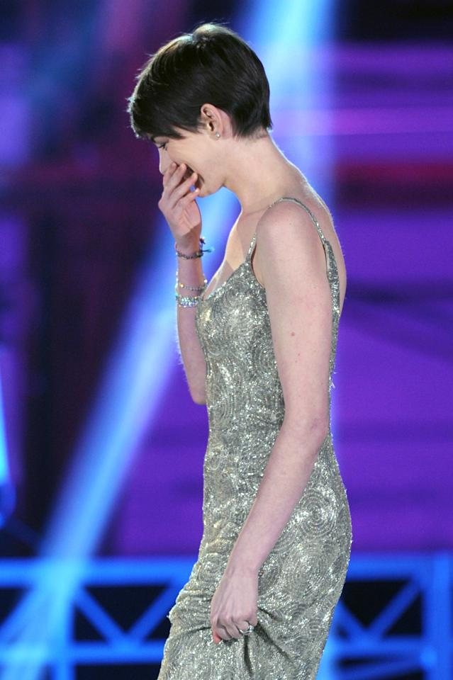 """SANTA MONICA, CA - JANUARY 10:  Actress Anne Hathaway accepts the Best Supporting Actress Award for """"Les Miserables"""" onstage at the 18th Annual Critics' Choice Movie Awards held at Barker Hangar on January 10, 2013 in Santa Monica, California.  (Photo by Kevin Winter/Getty Images)"""