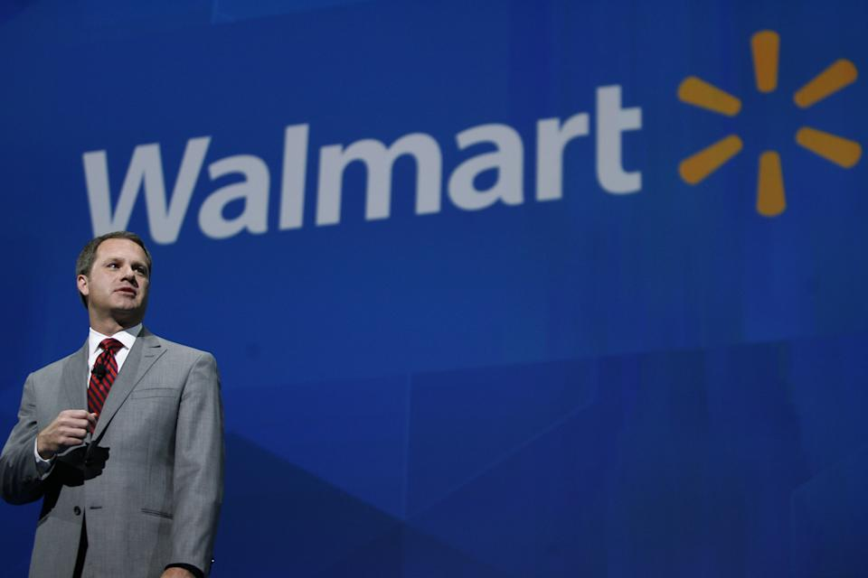 CORRECTS SPELLING OF LAST NAME TO MCMILLON INSTEAD OF MCMILLAN - President and CEO, Wal-mart International Doug McMillon addresses the crowd on the company 's 2012 worldwide sales during the Wal-mart shareholders meeting in Fayetteville, Ark., Friday, June 7, 2013. (AP Photo/Gareth Patterson)