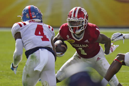 Indiana wide receiver Whop Philyor runs at Mississippi defensive back Tylan Knight after a catch during the first half of the Outback Bowl NCAA college football game Saturday, Jan. 2, 2021, in Tampa, Fla. (AP Photo/Chris O'Meara)