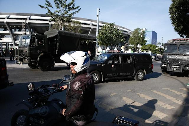 Rio police said in a statement that a man was mugging people near the Maracana stadium when he was intercepted by one of the police officers sent from another area of Brazil to Rio as part of the huge reinforcements (AFP Photo/Adrian Dennis)