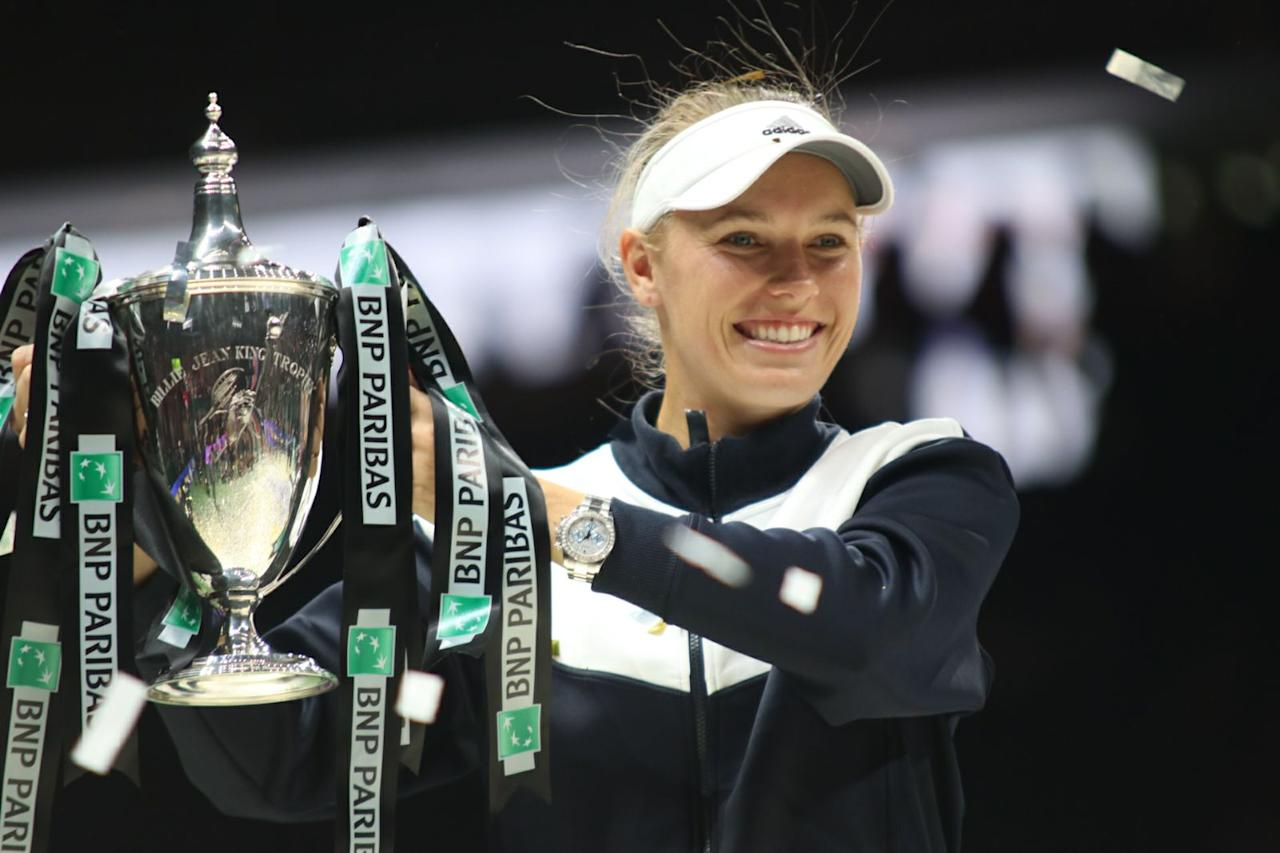 <p>Caroline Wozniacki with her trophy after winning the WTA Finals in Singapore. Photo: Yahoo News Singapore </p>