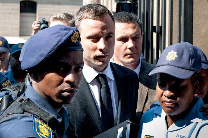 South African Paralympic athlete Oscar Pistorius arrives at the High Court in Pretoria on October 13, 2014 (AFP Photo/Stefan Heunis)
