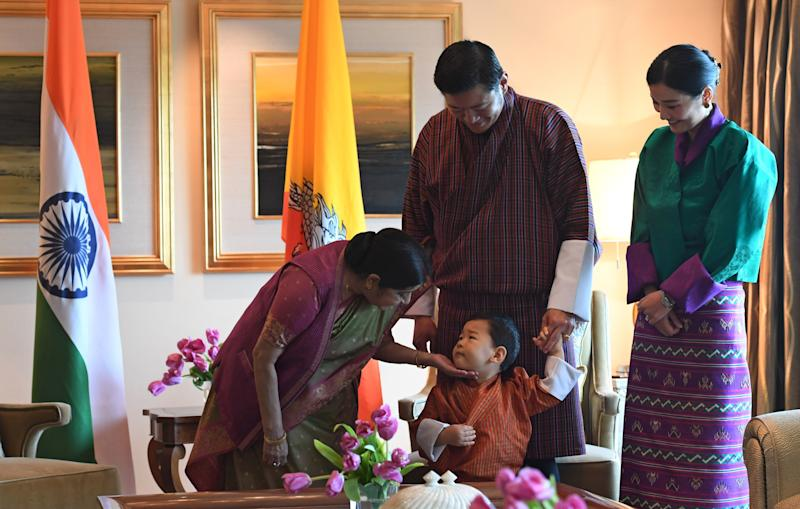 Indian Foreign Minister Sushma Swaraj, prince Jigme Namgyel Wangchuck, King Jigme Khesar Namgyel Wangchuck and Queen Jetsun Pema in New Delhi in November 2017.