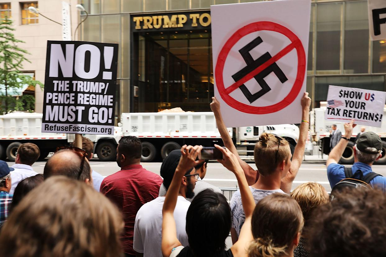 Hundreds of protesters gather outside of Trump Tower.