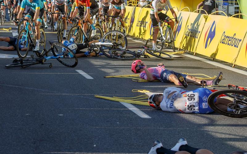 French cyclist Marc Sarreau (no.96) of team Groupama FDJ and other riders lie on the street following a crash in the sprint during the 1st stage of Tour de Pologne cycling race, over 195.8 km between Chorzow and Katowice, southern Poland, 05 August 2020. Dutch cyclist Fabio Jakobsen was put in an induced coma after a crash on stage one of the Tour of Poland on 05 August. Jakobsen crashed into the side barriers following a collision with his fellow Dutch Dylan Groenewegen while sprinting for the finish line. Jakobsen was declared winner of the stage while Groenewegen has been disqualified. - ANDRZEJ GRYGIEL/EPA-EFE/Shutterstock