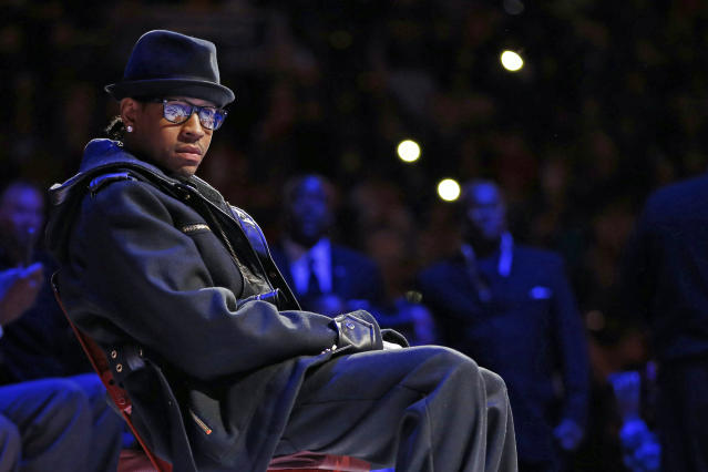 Former Philadelphia 76ers' Allen Iverson waits to speak during his retirement ceremony at half-time of an NBA basketball game between the Philadelphia 76ers and the Washington Wizards, Saturday, March 1, 2014, in Philadelphia. (AP Photo/Matt Slocum)
