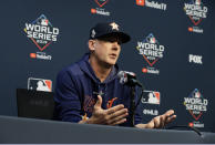 FILE - In this Oct. 28, 2019, file photo, Houston Astros manager AJ Hinch talks to the media during a news conference for baseball's World Series, in Houston. Houston manager AJ Hinch and general manager Jeff Luhnow were suspended for the entire season Monday, Jan. 13, 2020, and the team was fined $5 million for sign-stealing by the team in 2017 and 2018 season. Commissioner Rob Manfred announced the discipline and strongly hinted that current Boston manager Alex Cora — the Astros bench coach in 2017 — will face punishment later. Manfred said Cora developed the sign-stealing system used by the Astros. (AP Photo/Eric Gay, File)