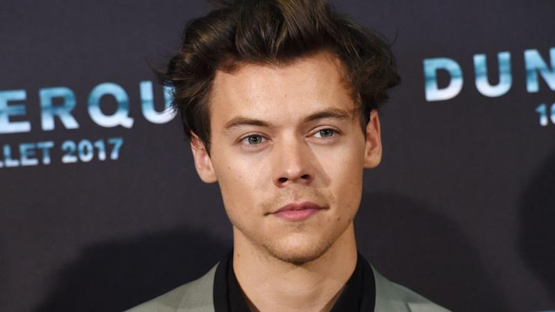 Harry Styles Strips Off For Rolling Stone Magazine Cover