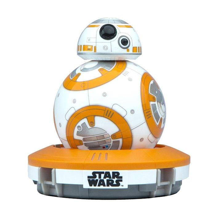 """<p><a class=""""link rapid-noclick-resp"""" href=""""https://www.amazon.com/BB-8-App-Enabled-Droid-Sphero-Trainer/dp/B071V56Q89?tag=syn-yahoo-20&ascsubtag=%5Bartid%7C10063.g.34738490%5Bsrc%7Cyahoo-us"""" rel=""""nofollow noopener"""" target=""""_blank"""" data-ylk=""""slk:BUY NOW"""">BUY NOW</a><br></p><p>With the release of a new <em>Star Wars</em> film for the first time in almost a decade, it's no surprise fans of the franchise were on-the-edge-of-their-seat excited. In the seventh installment, <em>The Force Awakens</em>, viewers were introduced to BB-8, the rolling droid. A company by the name Sphere designed an app-enabled droid that looks and acts, at your control, just like BB-8 does in the movie.</p>"""