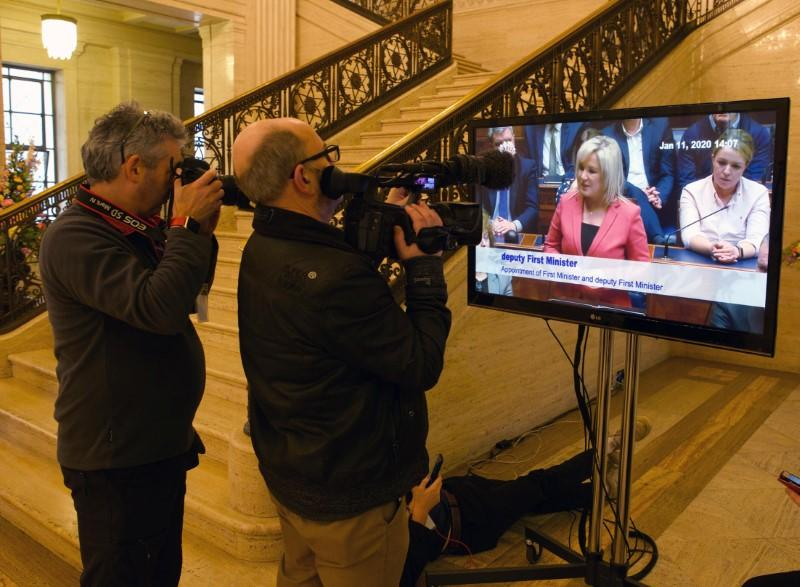 Cameramen film a television screen in the great hall as Deputy First Minister, Michelle O'Neill speaks as politicians in Northern Ireland returned to the Stormont Assembly after backing a deal to restore devolution in Belfast