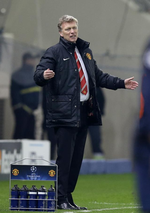 Manchester United's coach David Moyes reacts after to a players' mistake during a Champions League, round of 16, first leg soccer match against Olympiakos at Georgios Karaiskakis stadium, in Piraeus port, near Athens, on Tuesday, Feb. 25, 2014. Olympiakos won 2-0. (AP Photo/Thanassis Stavrakis)