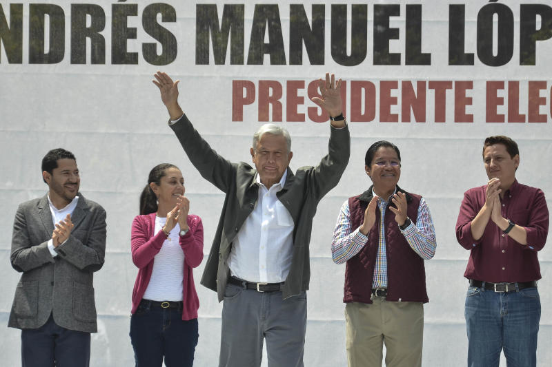 Mexico's President-elect Andres Manuel Lopez Obrador acknowledges the crowd at a rally commemorating the 50th anniversary of a bloody reprisal against students, at the Tlatelolco Plaza in Mexico City, Saturday, Sept. 29, 2018. Lopez Obrador vowed Saturday to never use military force against civilians. Troops fired on a peaceful demonstration at the plaza on Oct. 2, 1968, killing as many as 300 people at a time when leftist student movements were taking root throughout Latin America. (AP Photo/Christian Palma)