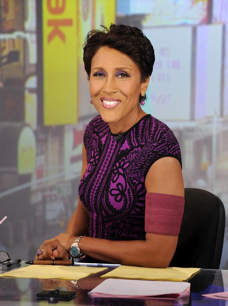"""FILE - This June 26, 2012 file image originally released by ABC shows co-host Robin Roberts wearing an armband that covers her pic line chemotherapy treatment, on """"Good Morning America,"""" in New York. Roberts is taking a little time off, saying she's feeling the effects of her blood and bone marrow disease. Roberts said Tuesday that she's """"not feeling too well"""" and would take some time off """"just to get some vacay."""" ABC said Roberts would be taking a few weeks of previously scheduled time off, but it came earlier than her planned medical leave for a bone marrow transplant. Roberts announced last month that she has MDS, a blood and bone marrow disease once known as preleukemia. (AP Photo/ABC, Ida Mae Astute)"""