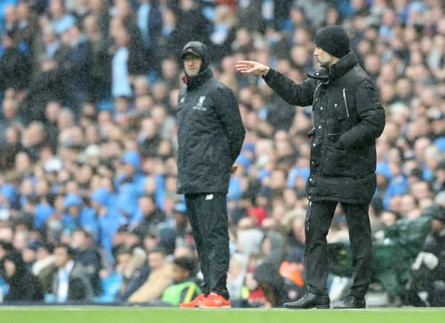 Pep Guardiola will send his side out to win when they take on Jurgen Klopp's Liverpool at Anfield (Martin Rickett/PA)