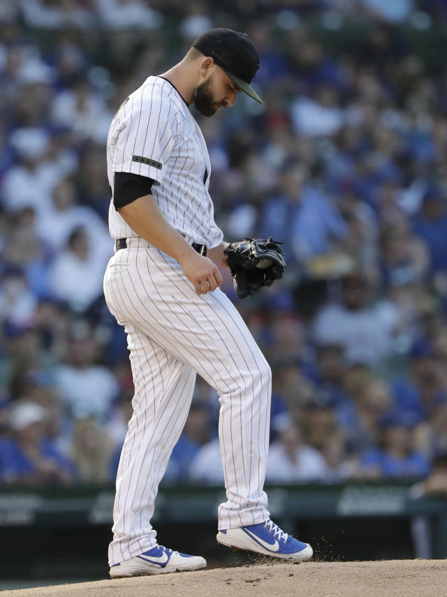 Chicago Cubs starting pitcher Tyler Chatwood kicks the mound during the first inning of a baseball game against the San Francisco Giants in Chicago, Sunday, May 27, 2018. (AP Photo/Nam Y. Huh)