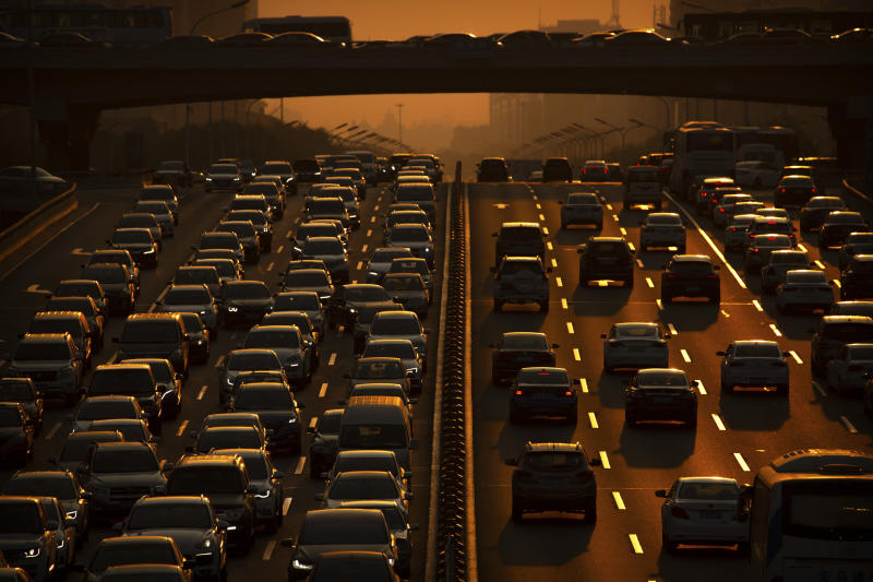 Commuters make their way along an expressway during rush hour in Beijing, Friday, Sept. 6, 2019. According to Chinese state media, the average concentration of PM2.5 fine air pollutants in Beijing in August was at the lowest level ever recorded for that month. (AP Photo/Mark Schiefelbein)