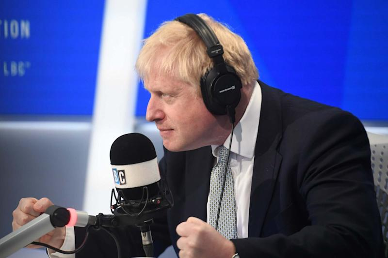 Under the spotlight: Boris Johnson answers questions in a live radio phone-in on LBC today (Jeremy Selwyn)